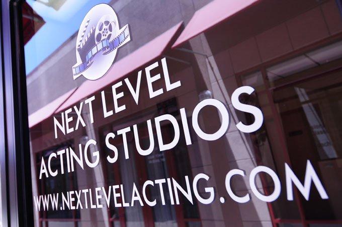 The Woodlands Studio Sign